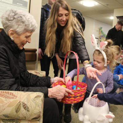 Resident giving a kid candy on Easter at Ebenezer Ridges Campus in Burnsville, Minnesota