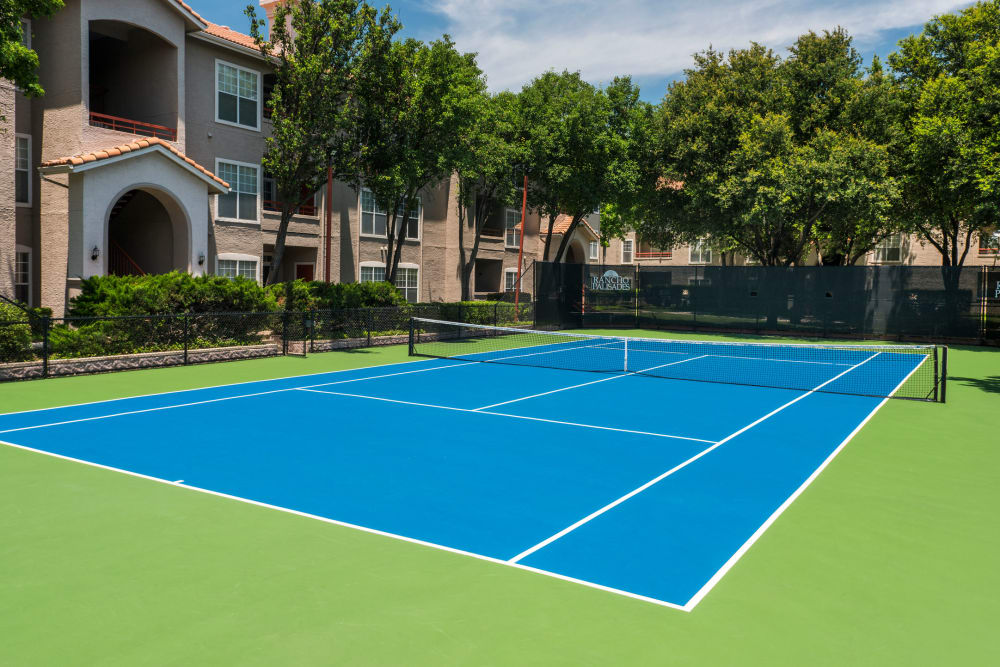 A tennis court with regulation lines at Rancho Palisades in Dallas, Texas