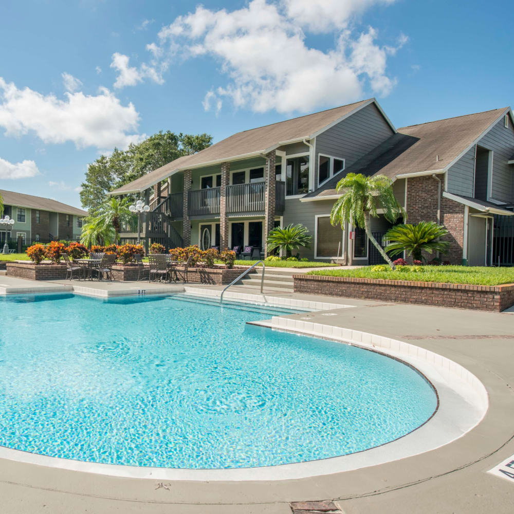 Large swimming pool with a sundeck at Compass in Melbourne, Florida