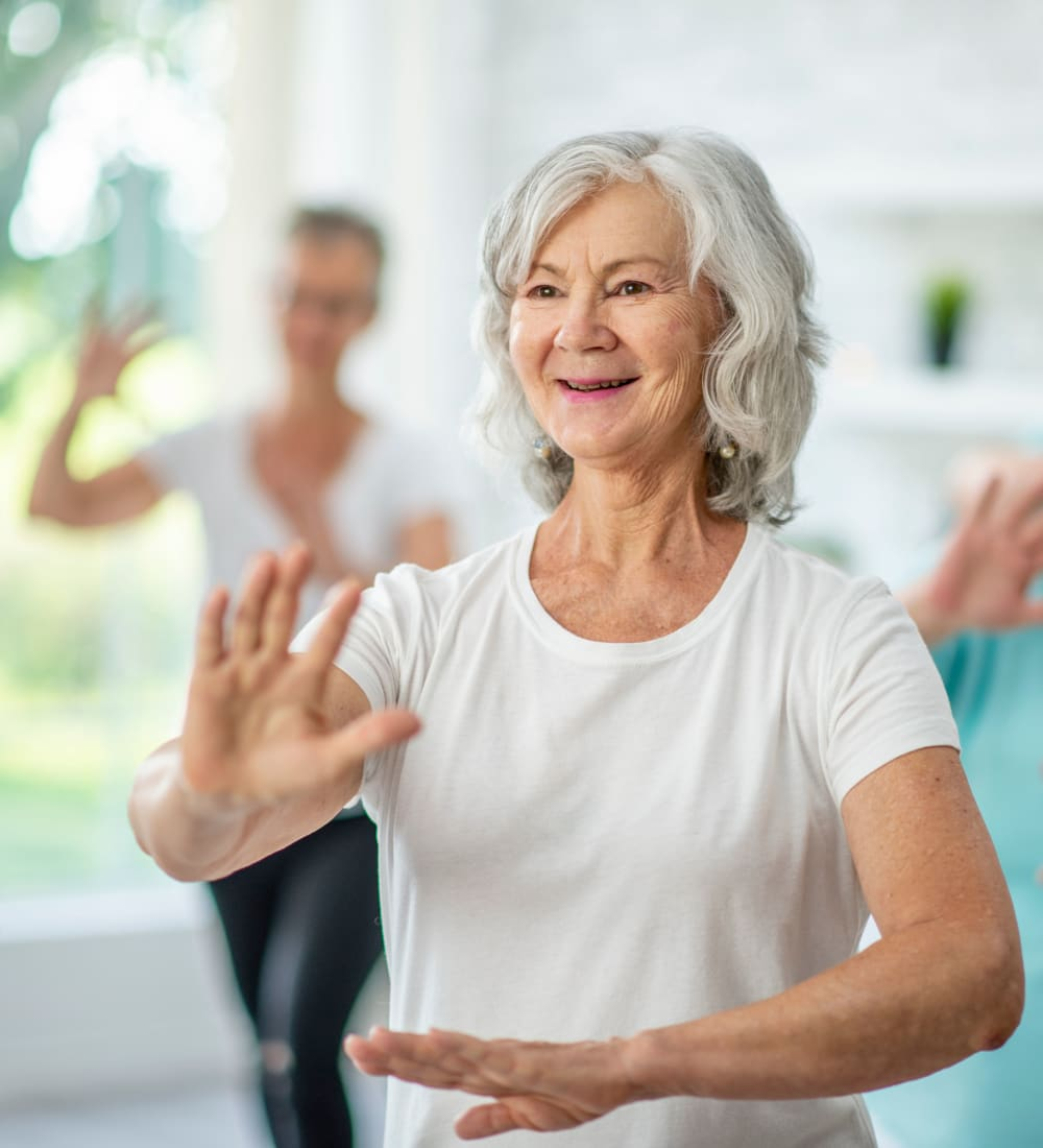 Resident taking a Tai Chi class at WellQuest of Elk Grove in Elk Grove, California
