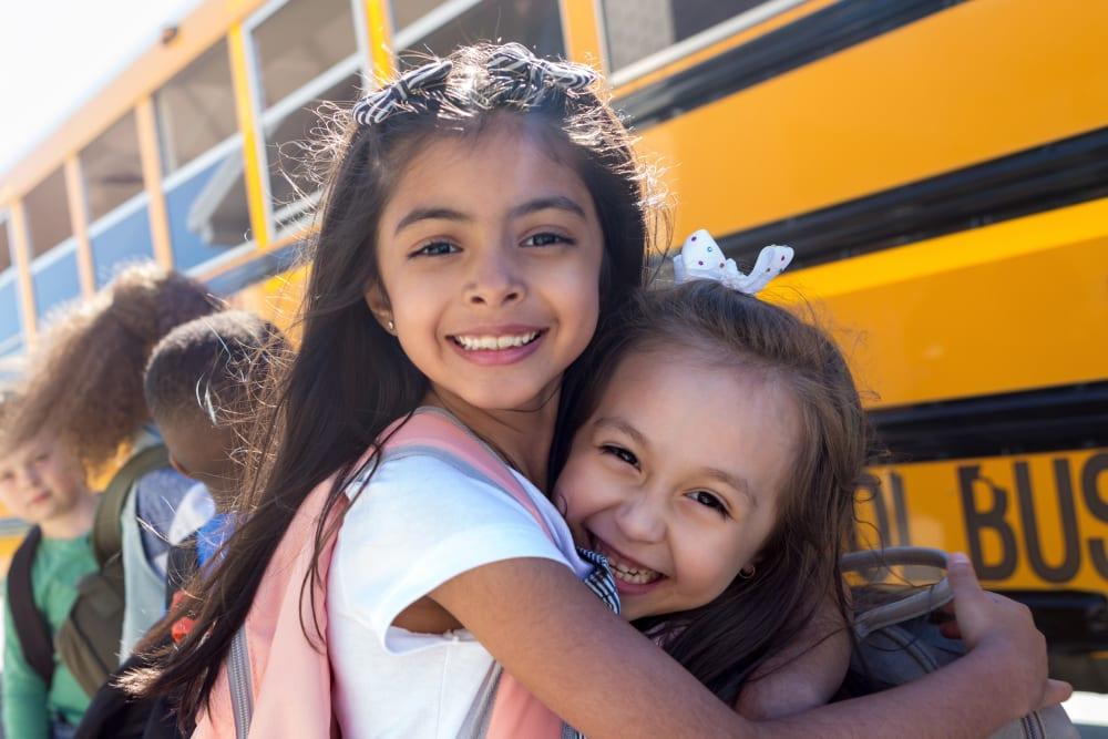 Children waiting at the bus stop near Plum Tree Apartment Homes in Martinez, California