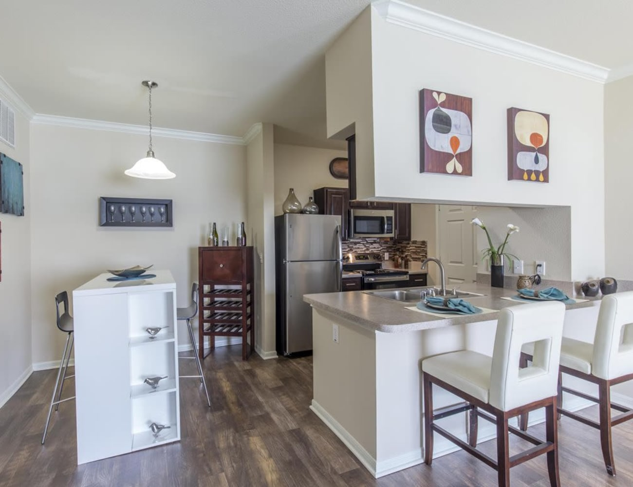 Open-concept layout with hardwood floors at Ranch at Hudson Xing in McKinney, Texas