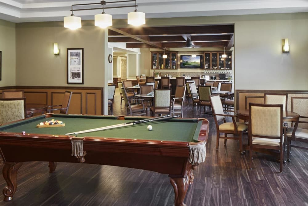 Deluxe game room with pool table at upscale senior living facility at {location_name}} in Medford, Oregon