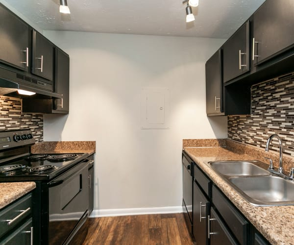 Black kitchen appliances at Candlewood Apartments in Nashville, Tennessee