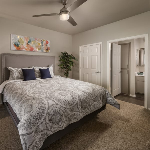 Well-decorated master bedroom with ceiling fan and bathroom at Bellagio in Scottsdale, Arizona