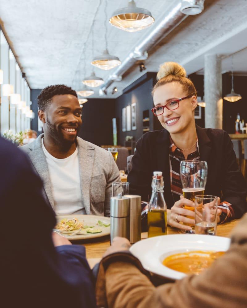 Residents eating together near Cimarron Pointe Apartments in Oklahoma City, Oklahoma
