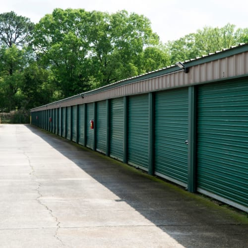 Outdoor storage units with green doors at Red Dot Storage in Denham Springs, Louisiana