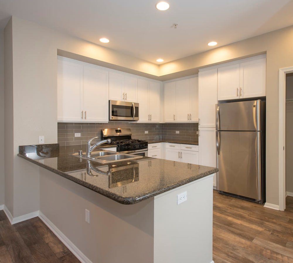 Kitchen with plenty of cabinet space at Paragon at Old Town in Monrovia, California