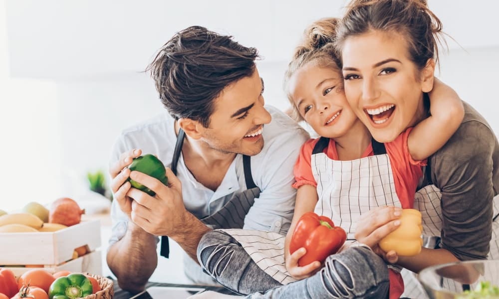 Young family cooking together