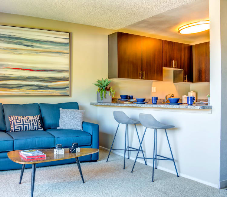 Retro-modern decor in the living area near the breakfast bar of a model home at Sofi Belmont Hills in Belmont, California