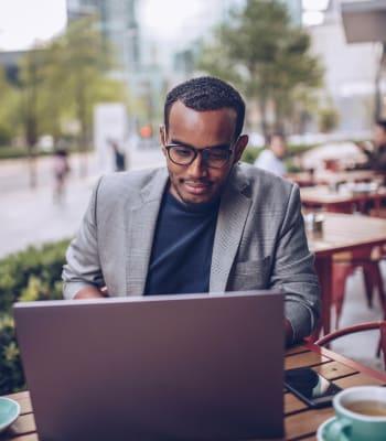 Resident working on their laptop at a cafe near Hidden Lake Condominium Rentals in Sacramento, California