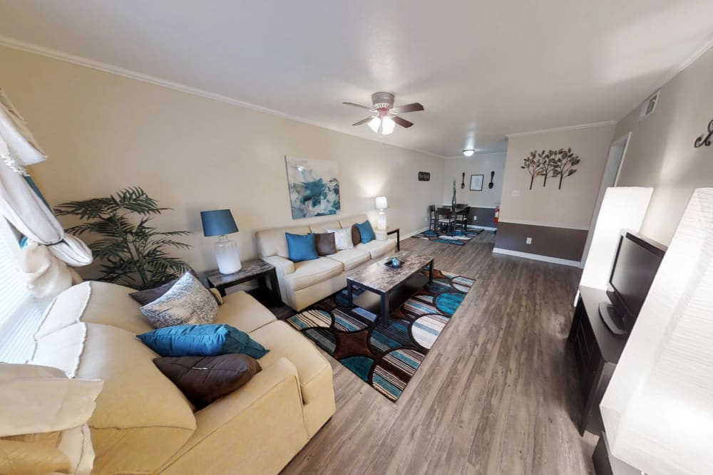 Well-decorated Living Room at Falls of Maplewood Apartments in Houston, Texas