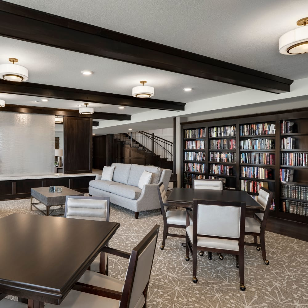 Resident library at Applewood Pointe of Maple Grove at Arbor Lakes in Maple Grove, Minnesota.