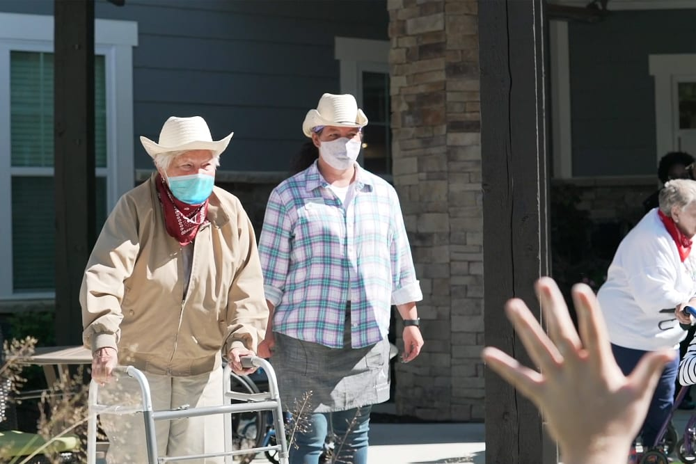 Two residents in masks at a Anthology Senior Living location