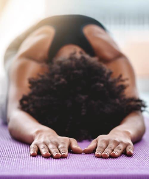 Resident enjoying meditative yoga in a studio near Waterhouse Place in Beaverton, Oregon