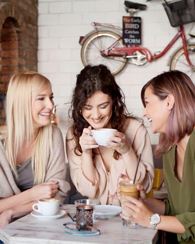 Friends enjoying coffee at Kinect @ Broadway's latte bar in Everett, Washington