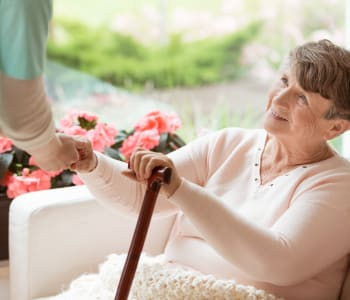 Nurse lending assistance to resident at Emerald Gardens in Woodburn, OR