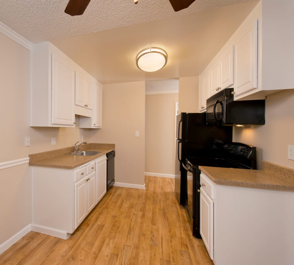 Kitchen with white cabinetry at Flora Condominium Rentals in Walnut Creek, California
