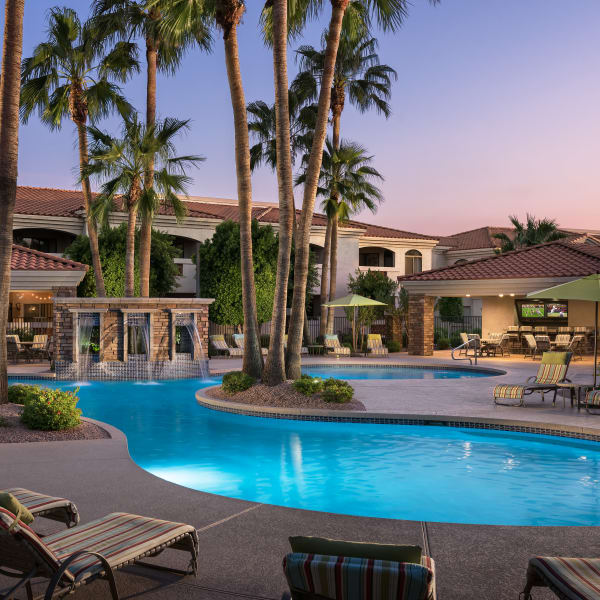 Luxurious resort-style swimming pool and hot tub at San Prado in Glendale, Arizona