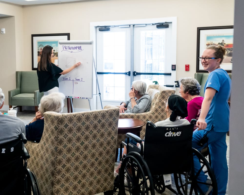Memory care residents enjoy a game of Pictionary at Harmony at Tucker Station in Louisville, Kentucky