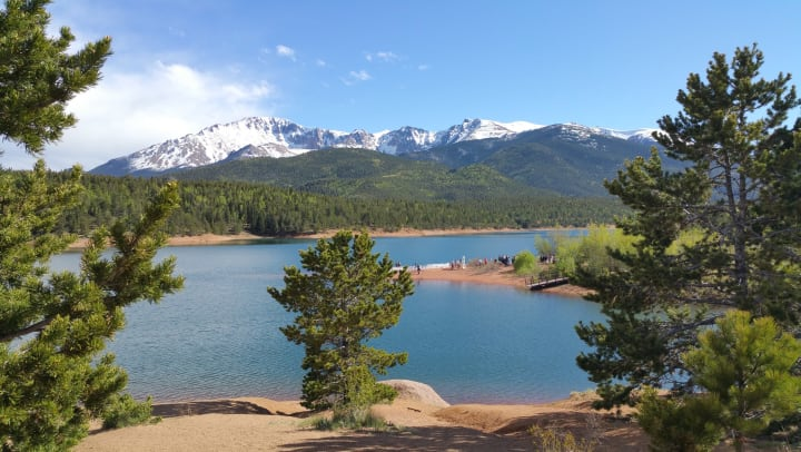 Scenery of trees, mountains, and water at Crystal Lake Reservoir