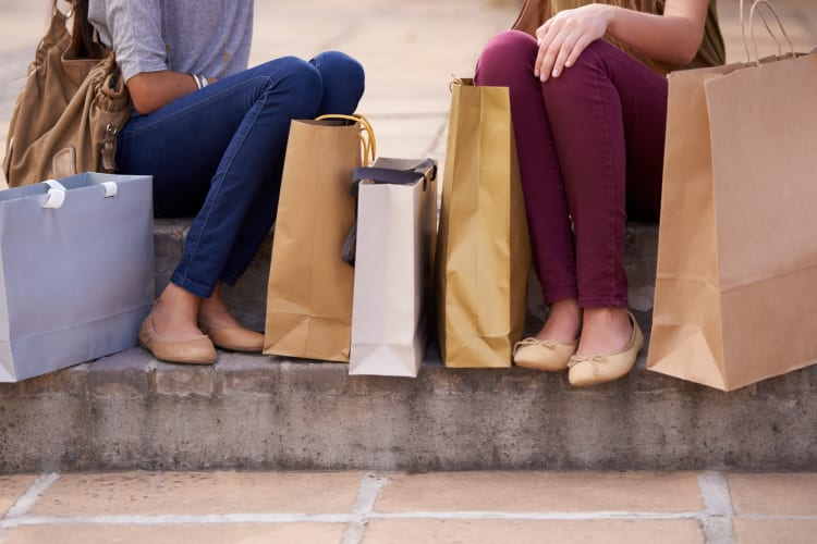 Women sitting on a step after shopping near Carriage House Apartments in Smyrna, Georgia