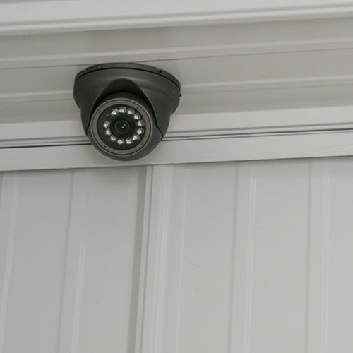 Security camera mounted indoors at Red Dot Storage in Searcy, Arkansas