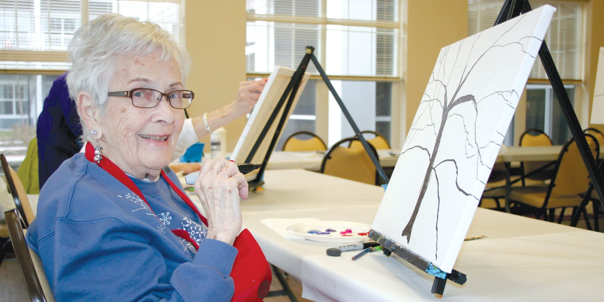 A resident from Alexis Estates Gracious Retirement Living in Allen, Texas, painting