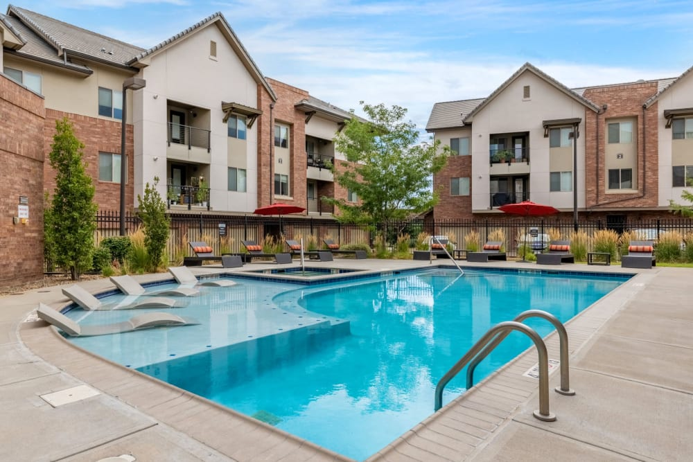 A poolside sundeck with plenty of lounge chairs at The Parc at Greenwood Village in Greenwood Village, Colorado