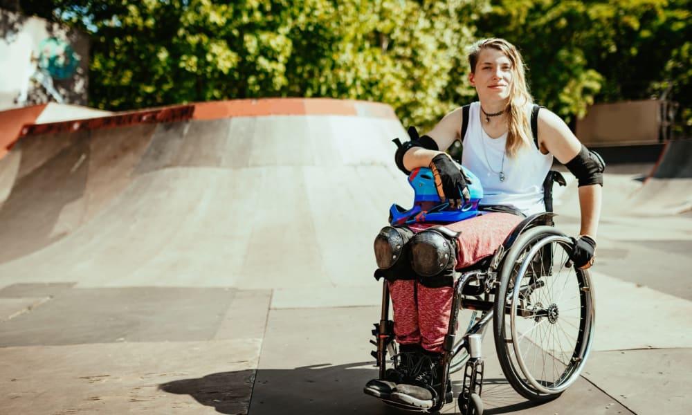 Resident shredding her wheelchair at the skatepark near The Landings at Steeplechase in Houston, Texas