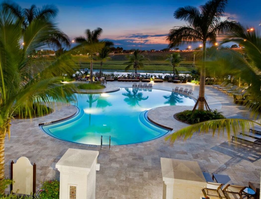 Beautiful resort-style swimming pool at dusk at Doral View Apartments in Miami, Florida