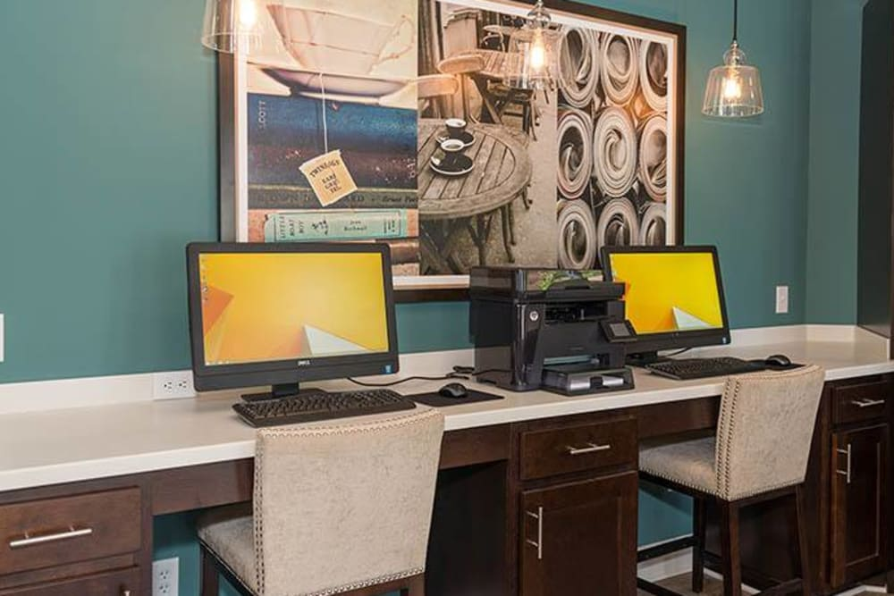 A clubhouse with a business station at Residences at Belmont in Fredericksburg, Virginia