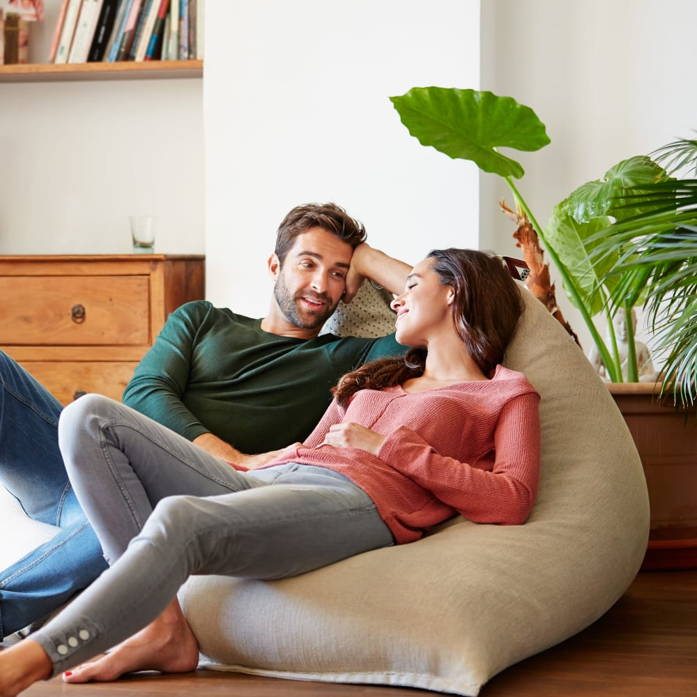 Couple lounging on a bean bag chair at Essential Property Management in Ferndale, Michigan