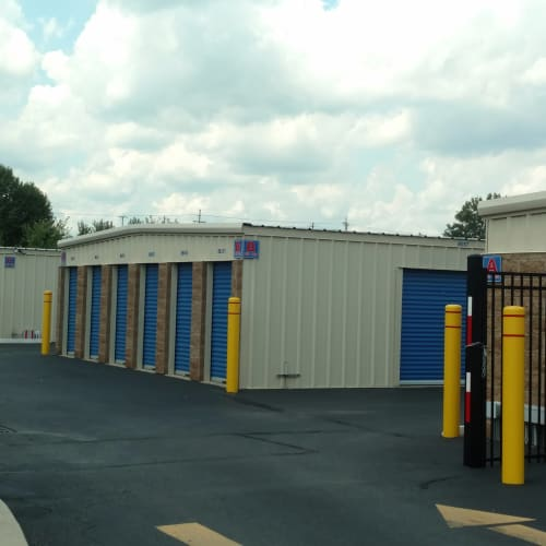 Wide driveway in front of outdoor storage units at Red Dot Storage in New Albany, Indiana