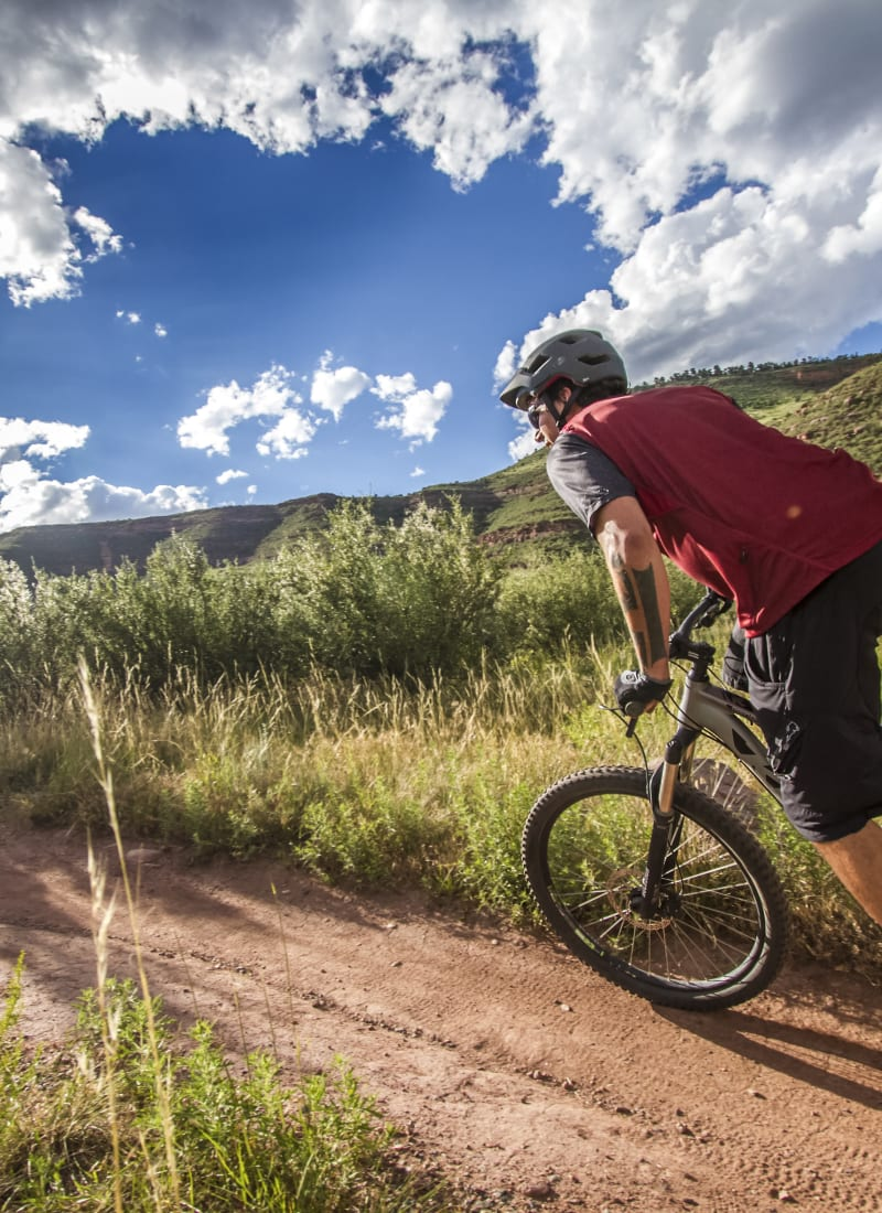 Resident riding their bike near Ashford Belmar in Lakewood, Colorado