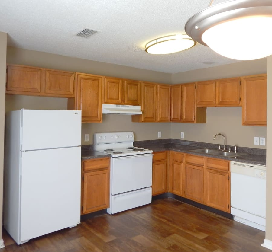 Kitchen with white appliances at Cypress Creek Townhomes in Goodlettsville, Tennessee