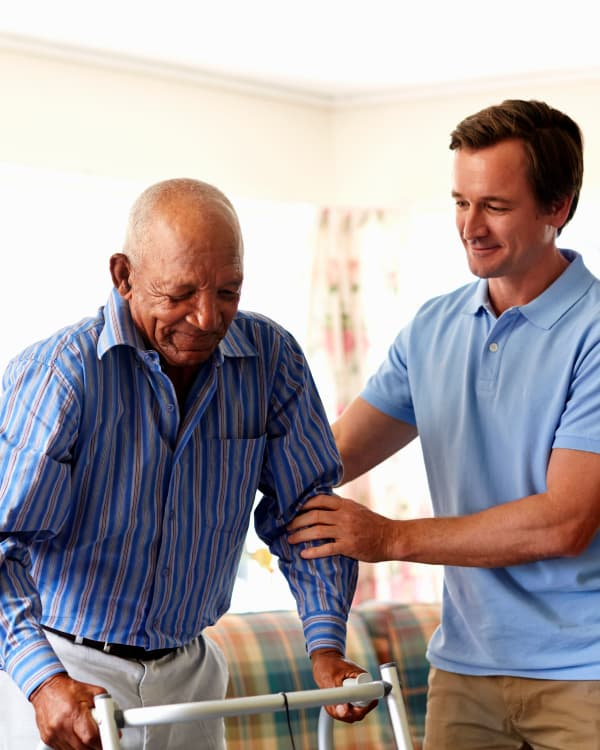 A caretaker helping a resident at Trilogy Health Services in Louisville, Kentucky
