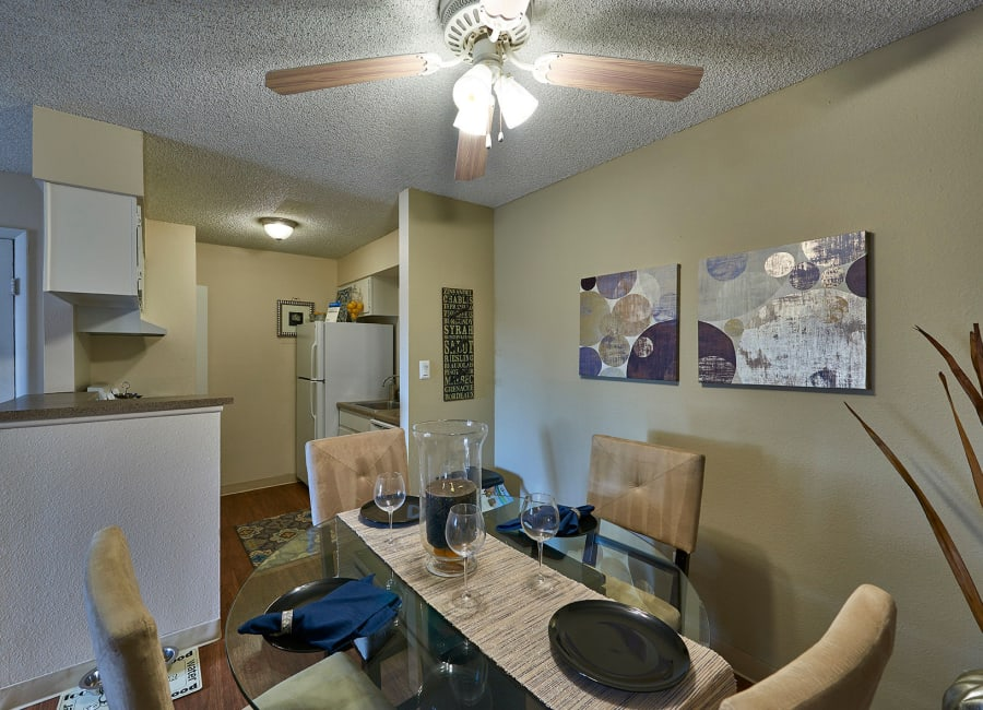 Well-decorated dining area in a model home at Hampden Heights Apartments in Denver, Colorado