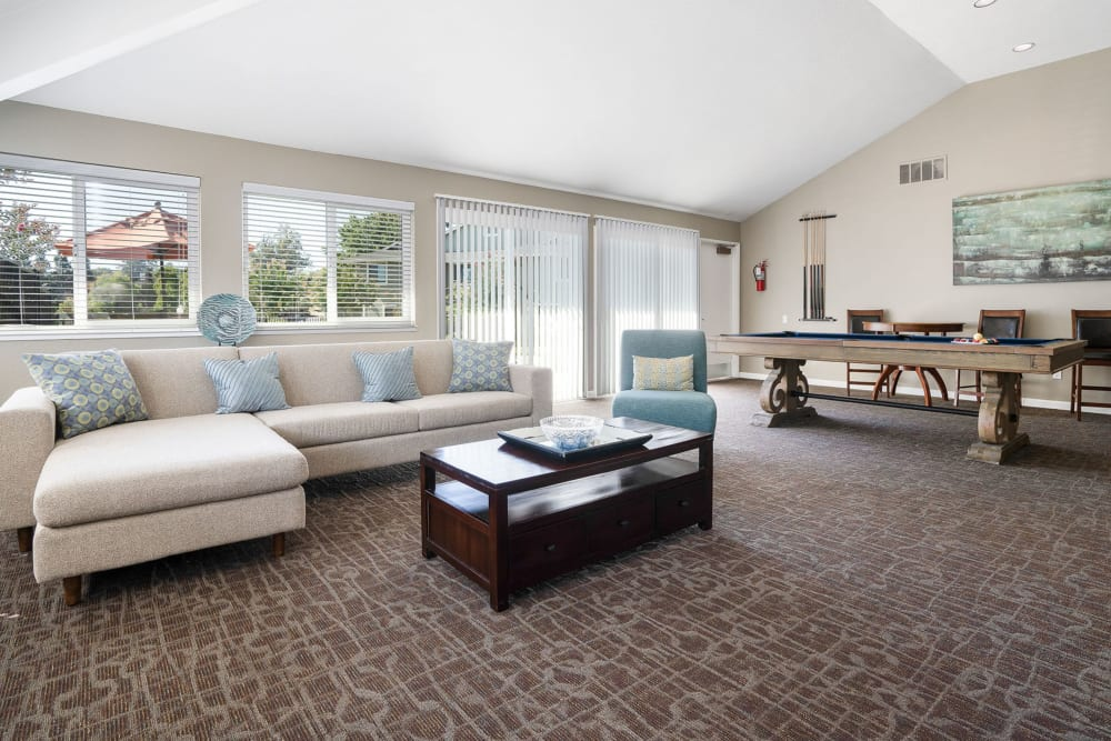 Spacious clubhouse with large windows at Ridgecrest Apartment Homes in Martinez, California