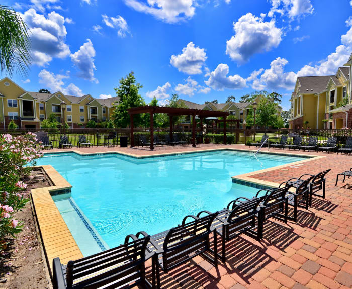 Inviting swimming pool on a beautiful day at IMT Kingwood in Kingwood, TX