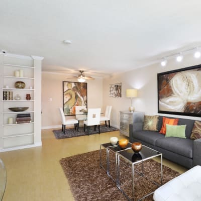 Open-concept layout with built-in shelving in the living area of a model home at Sofi Redwood Park in Redwood City, California