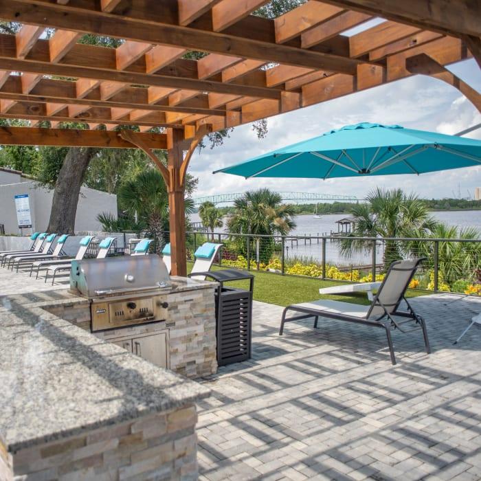 Grilling area alongside the sparkling St Johns River at Pier 5350 in Jacksonville, Florida