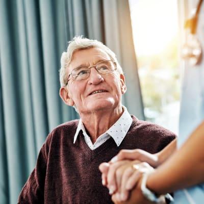 A resident talking to a staff member at Ebenezer Ridges Campus in Burnsville, Minnesota