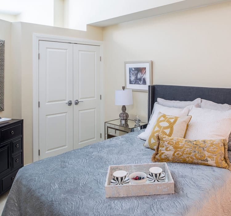 Well-appointed assisted living bedroom at Village at Belmar