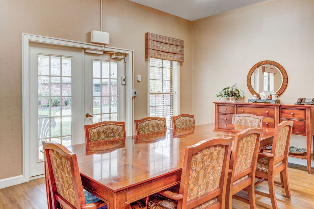Large community dinning table with wood accents at Carriage Court of Lancaster in Lancaster, Ohio