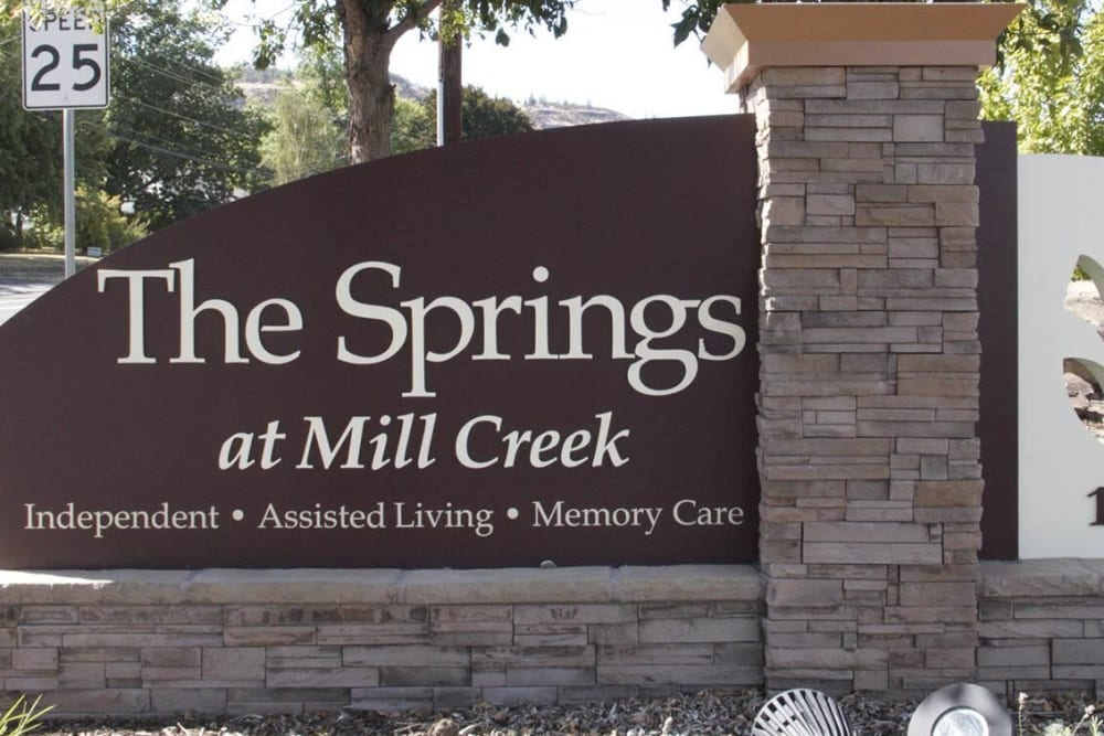 Front entrance sign complete with stone detailing at The Springs at Mill Creek in The Dalles, Oregon