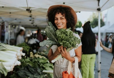 Resident shopping for produce at a local farmer's market near Governours Square in Columbus, Ohio