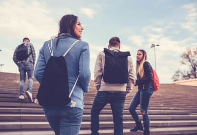 Students walking to school near New Orleans Park Apartments in Secane, Pennsylvania