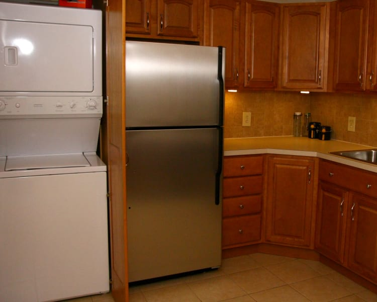 Stainless steel refrigerator and washer and dryer set at Riverwood Commons