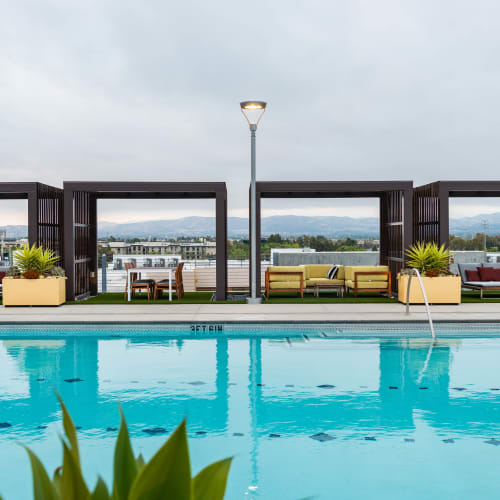 Private cabanas at the rooftop swimming pool at Fusion Apartments in Irvine, California